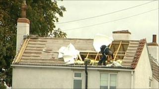 Royden Toon removing roof tiles
