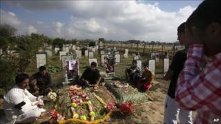 Kashmiris mourn at Martyrs' Graveyard in Srinagar.