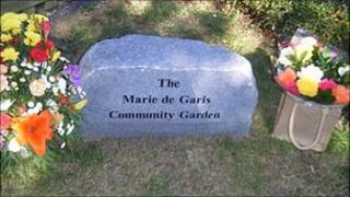 The Marie de Garis Community Garden dedication stone