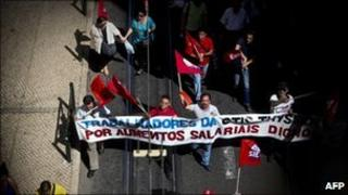 Workers march as they protest against government austerity measures during demonstration