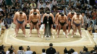 Japan Sumo Association acting president Hiroyoshi Murayama and sumo wrestlers in Nagoya, Japan