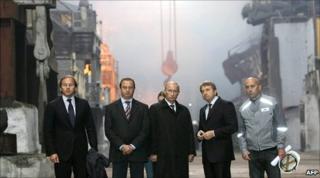 Russian Prime Minister Vladimir Putin (centre) visits Norilsk Nickel's copper plant in the Arctic city of Norilsk