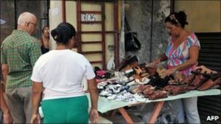 A woman sells shoes in Havana