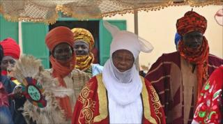 The emir of Zazzau, a traditional ruler, with courtiers and advisors arriving for a ceremony