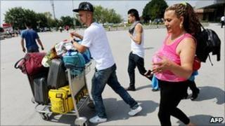 A Roma family arrive at Pristina airport from Germany in July 2010