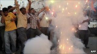Members of Vishwa Hindu Parishad (VHP) and Bajrang Dal set off firecrackers in Amritsar on September 30, 2010