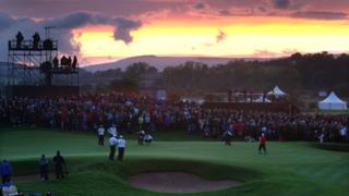 The 10th green as late evening light fades in the distance