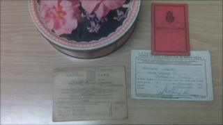 Old driver's licence and tin