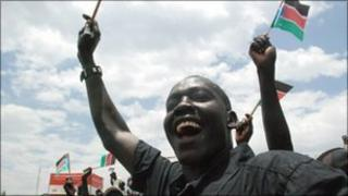 Southern Sudanese in the capital Juba, waving flags to welcome home their leader recently