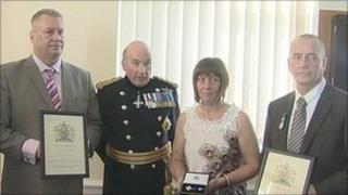 Gen Sir Richard Dannatt with members of Raymond Hall's family