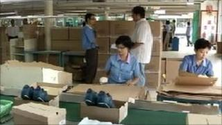 Workers at the Prima Inreksa shoe factory outside Jakarta