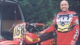 Stephen Allan Williams with one of his motorcycles