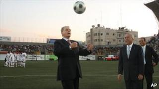 IOC president Jacques Rogge with Palestinian Prime Minister Salam Fayyad before a football match in the West Bank on Tuesday