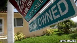 Home with bank owned sign