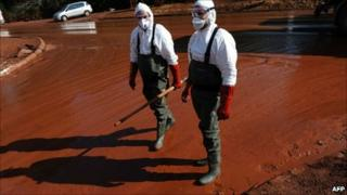 Toxic spill workers in Devecser, 150 km (93 miles) west of Budapest, Hungary - 11 October 2010