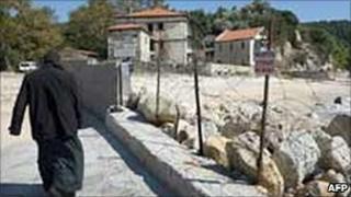 A monk walks towards the monastic community of Mount Athos. Photo: October 2008