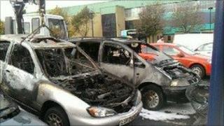 The damaged cars