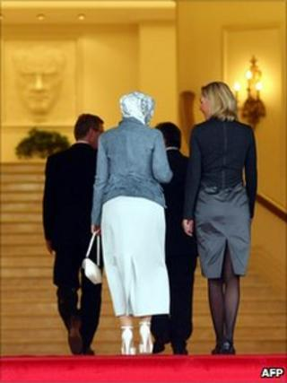 The wives of the Turkish (left) and German presidents follow their husbands into the Cankaya Presidential Palace in Ankara, 19 October