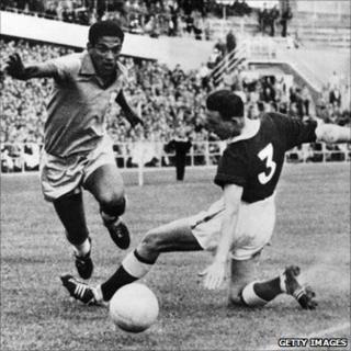 Brazilian forward Garrincha and Welsh defender Mel Hopkins during the 1958 World Cup quarter final in Goteborg, Sweden