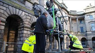 The statue being removed from its plinth (Pic by Frank McGrail)
