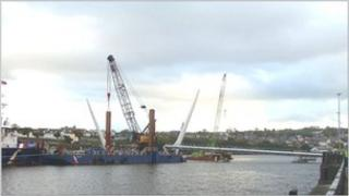 The 1000 tonne barge, the Forth Atlas, at the construction site as the first sections of the bridge are put in place