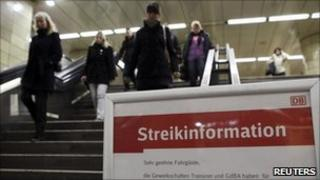 A message board warns of disruption due to strike action at a Berlin railway station, 26 October