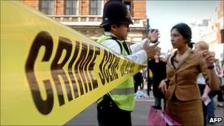 Policeman stopping pedestrian from entering Liverpool Street in 2006