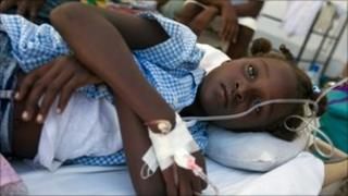 A girl receives treatment for cholera in St Marc, Haiti (26 Oct 2010)