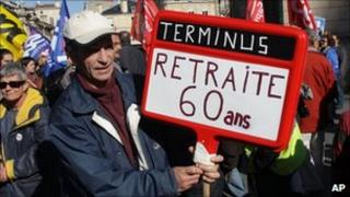 "A protester in Bordeaux holds a placard reading: ""Terminus: Retirement at 60"" (20 Oct 2010)"