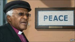"Desmond Tutu walks past a street mosaic which reads ""Peace"" on the green line that separates the Greek Cypriot side from the Turkish military-controlled areas in the heart of Nicosia (2008)"