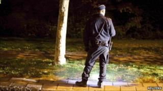 A police officer investigates a crime scene in Malmo, Sweden, October 20, 2010