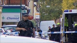 Armed police at scene