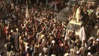 A militant leader addresses a crowd in Muzaffarabad
