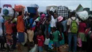 People getting ready to leave a camp in Corail in Haiti