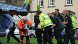 The casualty being loaded into a helicopter