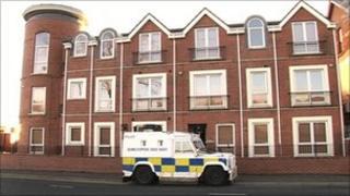 Flats where pensioner's body was found