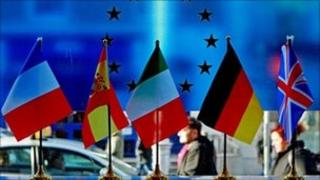 Five european flags on a table