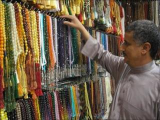 A man checks his wares at a stall in Mecca