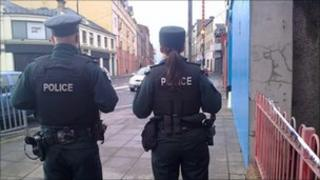 The police are at the scene of the attack in John Street