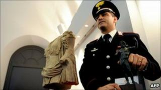Michele Speranza, who spotted the stolen torso for sale in New York, pictured with the statues at a Rome press conference, 19 November 2010