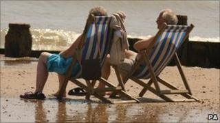 An elderly couple on a beach