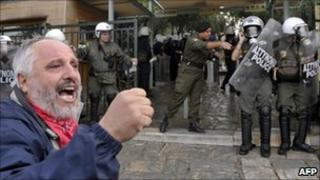 A protester outside the Acropolis in Athens (25 Oct 2010)
