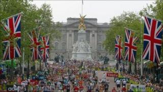 London Marathon participants run down The Mall
