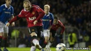 Wayne Rooney tucks away a late penalty at Ibrox