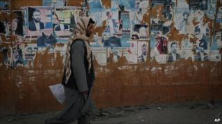 Defaced election posters of parliamentary candidates taking part in September's poll in Kabul