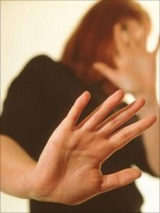 Woman shielding herself from a violent partner.