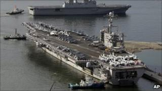 File image (from July 2010) of the USS George Washington, bottom, and the South Korean navy's landing ship Dokdo Ham