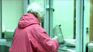 Pensionner collecting pension in post office