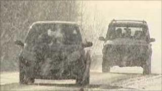 Two cars in snow storm