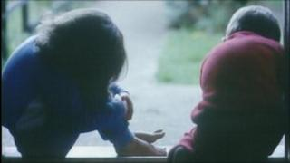 Children crying on doorstep (posed by models)